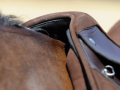 Saddle shown on medium withered horse